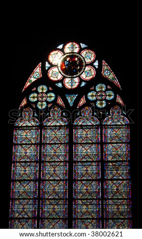 Stained-glass window. Notre Dame Cathedral. Paris, France - stock photo