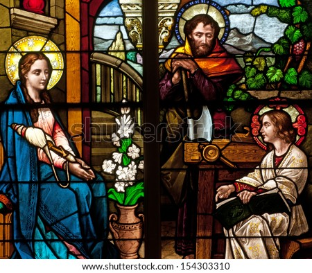 Stained glass window of Holy Family, Jesus, Mary and Joseph - stock photo
