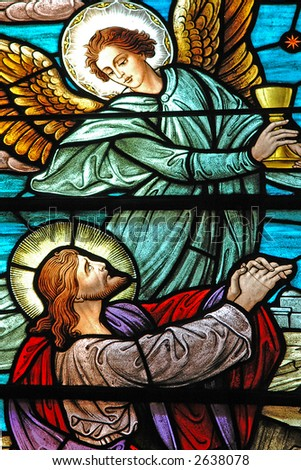 Stained glass window of Jesus and Angel from 1899 - stock photo