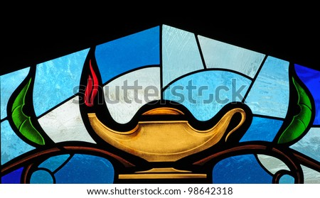 Stained glass window of oil lamp, symbol of wisdom - stock photo
