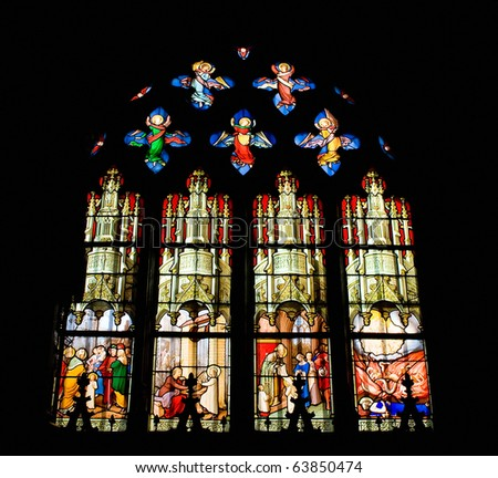 Stained glass window of Saint Etienne church in Paris - stock photo