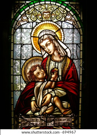 stained glass window of virgin mary and christ child - stock photo