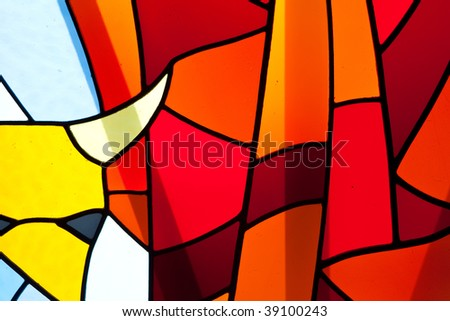 stained glass window on an old church - stock photo