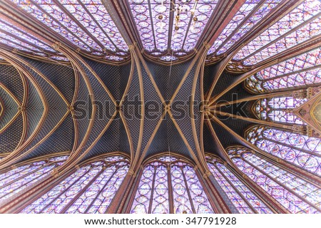 Stained glass windows inside the Sainte Chapelle a royal Medieval chapel in Paris, France - stock photo