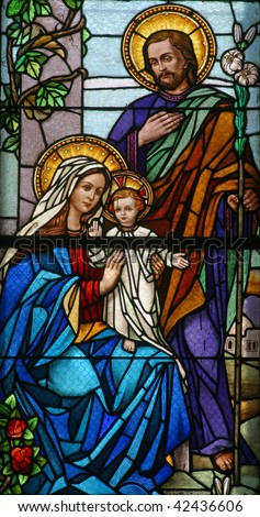 Stained glass with Holy Family - stock photo