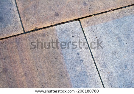 Stained & Marked Wet Paving Slabs with Diagonal Edges - stock photo