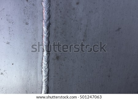 Stained steel plate with weld seam, industrial background texture