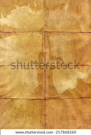 Stained vintage folded paper page - stock photo