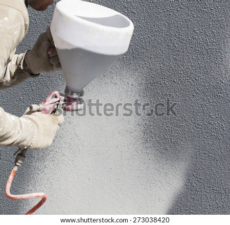 Staining wall covering composite resin of Spray gun - stock photo