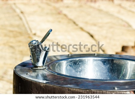 Stainless drinking water tap  in the park. - stock photo