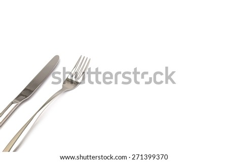 Stainless metal Knife and fork kitchenware isolated on white background