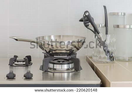 stainless pan on gas stove in kitchen - stock photo