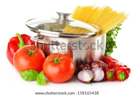 Stainless pot with spaghetti and variety of raw vegetables isolated on white - stock photo