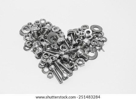 Stainless screws on white background Put a heart shape