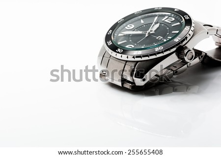 Stainless steel analog watch in isolated background. - stock photo
