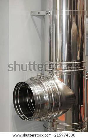 Stainless steel chimney stove pipe installation - stock photo