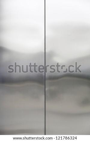 Stainless steel, closed metal door detail, interior - stock photo