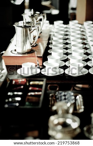 Stainless steel coffee pot White coffee cup - stock photo