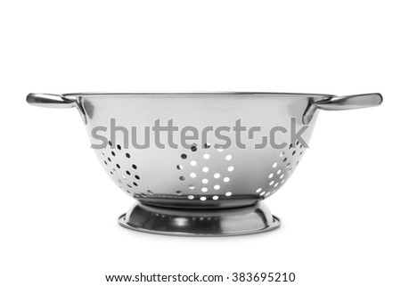 Stainless steel colander on white background - stock photo