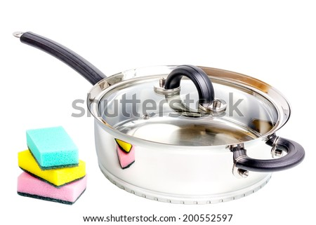 Stainless steel deep stewing pan with sponges isolated on white background