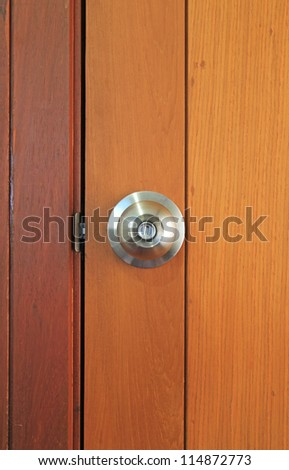 Stainless steel door knob on wooden door