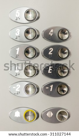 Stainless Steel Elevator Panel Push Buttons. - stock photo