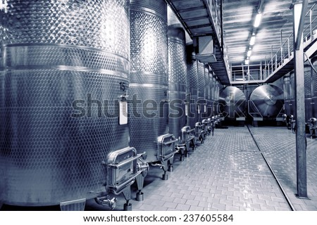 Stainless steel fermenters used to make wine, toned image - stock photo