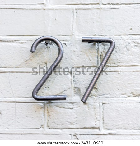 Stainless steel house number twenty seven - stock photo