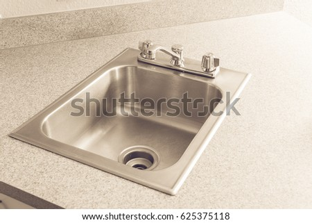 stainless steel kitchen sink and faucet on a yellow granite worktop decoration water tap and - American Kitchen Sink