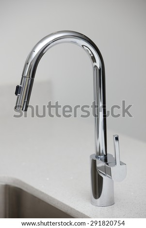 Stainless Steel kitchen sink faucet - stock photo