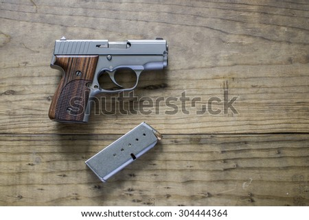 Stainless Steel 9mm Pistol and magazine - stock photo