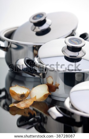 Stainless steel pans with onion