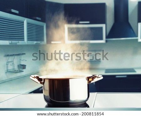 Stainless steel pot with steam - stock photo