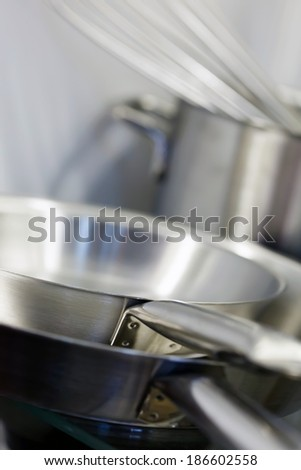 Stainless steel pots and pans - stock photo