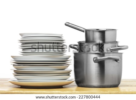 Stainless Steel pots on a kitchen table top - stock photo