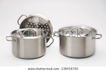 stainless steel pots with white background, studio shot - stock photo