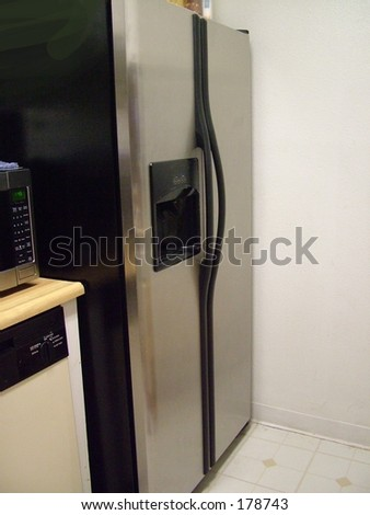 Stainless steel refrigerator in small kitchen