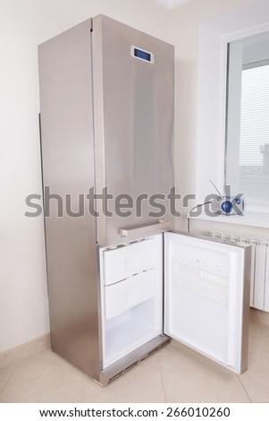 Stainless steel refrigerator - open the freezer door - stock photo