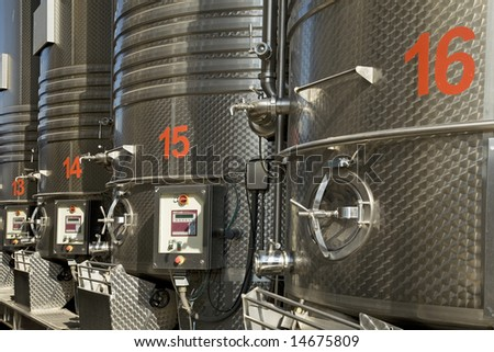 Stainless steel reservoirs for  wine - stock photo