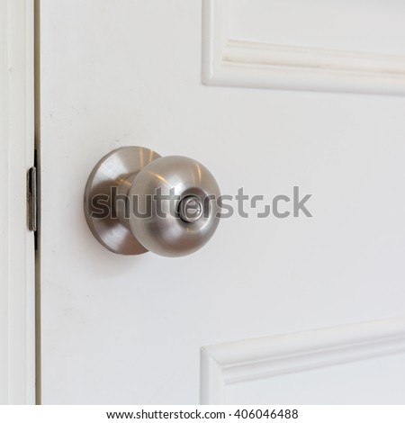 stainless steel round ball door knob. - stock photo