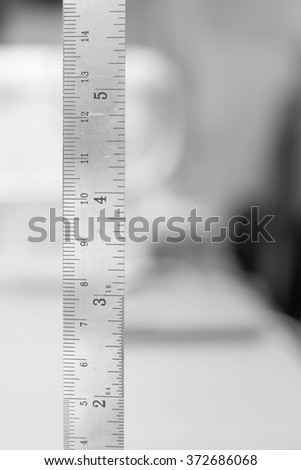 stainless steel ruler with blurry white background