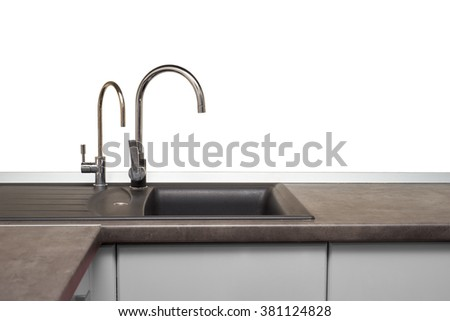 stainless steel sink and faucet in kitchen room - stock photo