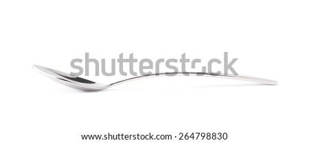 Stainless steel small kitchen dessert spoon isolated over the white background - stock photo