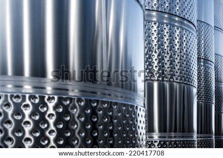 Stainless steel tank at the winery for wine maturation - stock photo