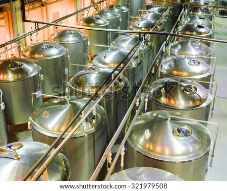 Stainless steel tanks. Food industry. - stock photo