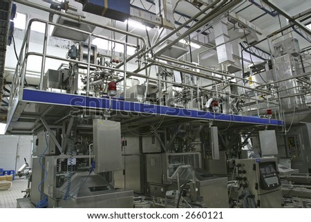 stainless steel temperature control valves and pipes  in modern dairy - stock photo