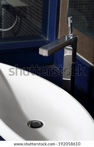 stainless steel water tap in modern interior
