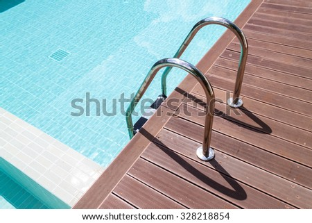Stair at swimming pool in sunny day,