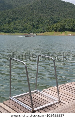 stair of natural swimming pool, natural lake and hillside