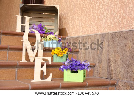 Stair steps decoration with wildflowers and decorative letters - stock photo